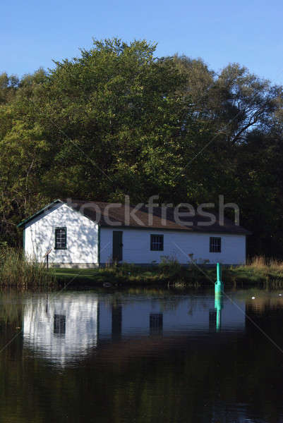 White Shed at the Water Edge Stock photo © AlphaBaby