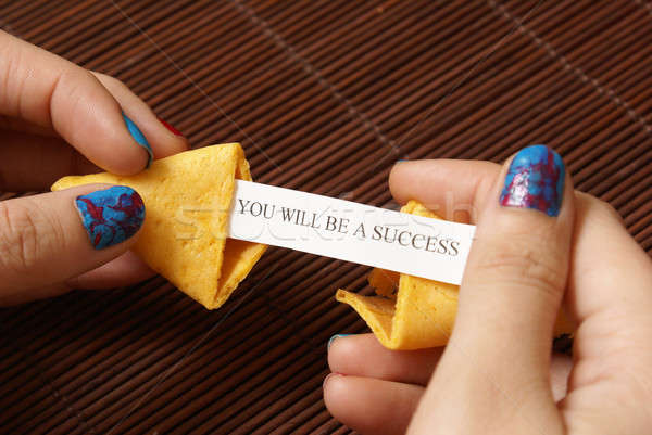 Apertura fortune cookie donna nascosto messaggio carta Foto d'archivio © AlphaBaby
