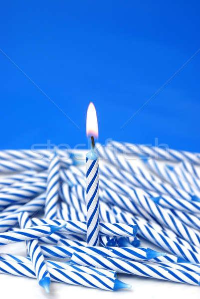 Uno llameante vela unicidad feliz cumpleanos Foto stock © AlphaBaby