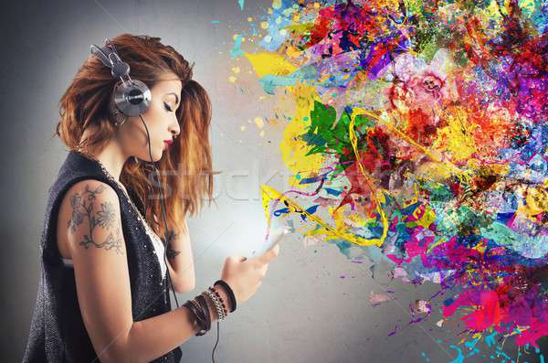 Tattoo girl listens to music Stock photo © alphaspirit