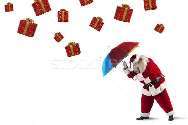 Vs geschenken storm kerstman beschermd paraplu Stockfoto © alphaspirit