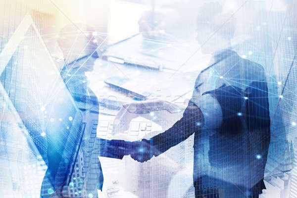 Abstract business handshake. Concept of partnership and teamwork. Double exposure Stock photo © alphaspirit