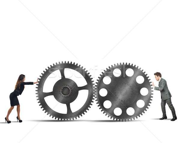 Interlocking gears Stock photo © alphaspirit
