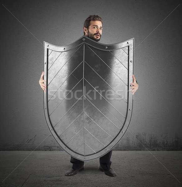испуганный бизнесмен человека сокрытие за большой Сток-фото © alphaspirit