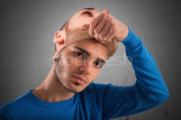 Teenager with adult mask Stock photo © alphaspirit