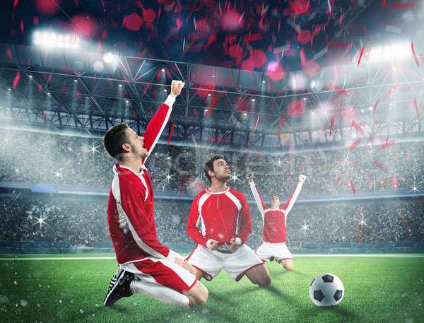 Ganhar jogo de futebol futebol jogadores estádio campo Foto stock © alphaspirit