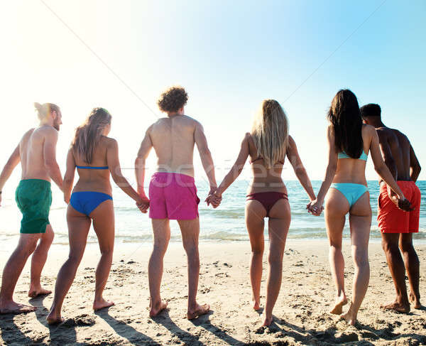 Group of friends hold hands to one another Stock photo © alphaspirit
