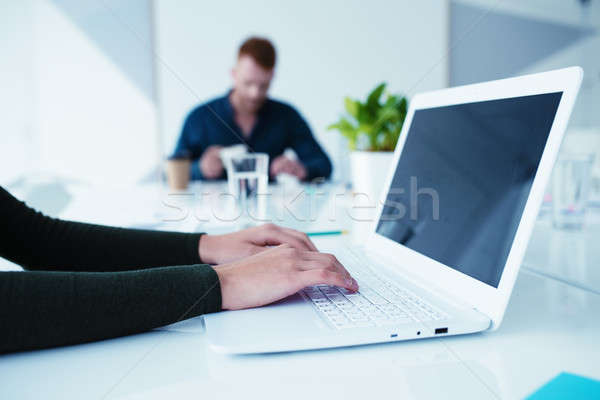 Girl works on a laptop. Concept of internet sharing and interconnection Stock photo © alphaspirit