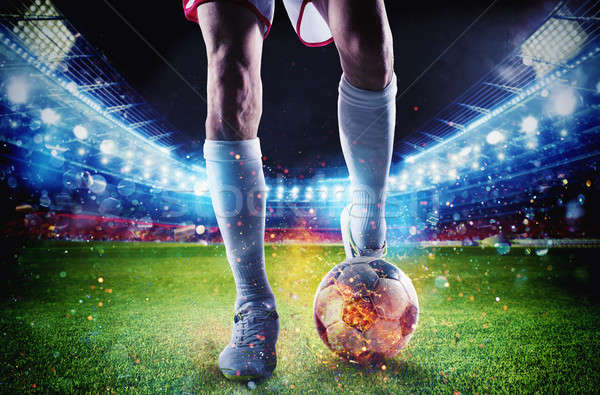 Soccer player with soccerball on fire at the stadium during the match Stock photo © alphaspirit