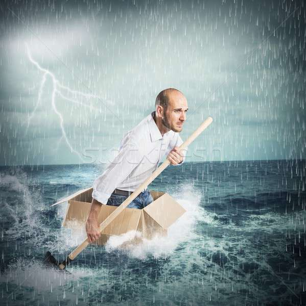 Paddling in the storm Stock photo © alphaspirit
