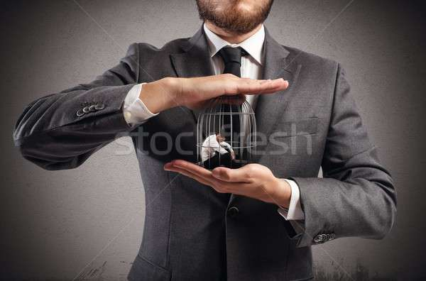 Caged  businessman Stock photo © alphaspirit