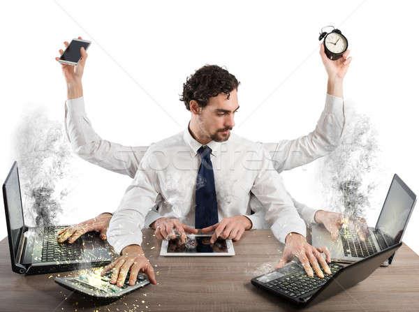 Overworked businessman Stock photo © alphaspirit