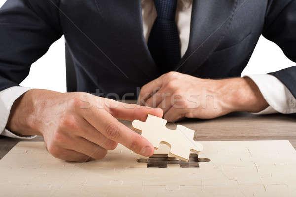 Compleet puzzel zakenman laatste stuk business Stockfoto © alphaspirit