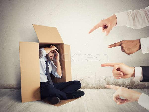 Colpevole imprenditore colleghi nascondere cartone business Foto d'archivio © alphaspirit