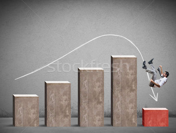 Businessman falls on a negative statistic Stock photo © alphaspirit