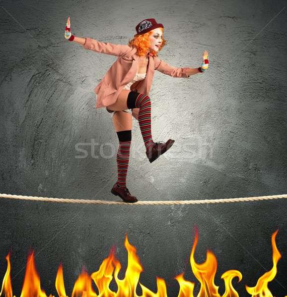Clown balance on fire Stock photo © alphaspirit
