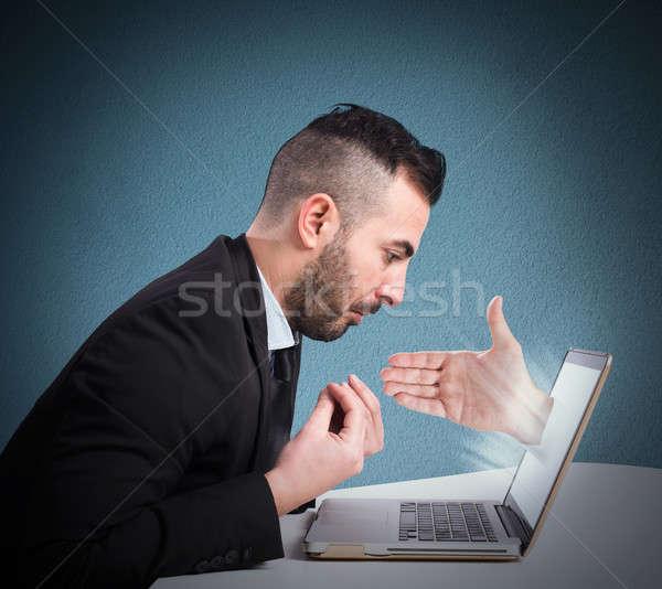 Férfi háló kéz ki üzlet számítógép Stock fotó © alphaspirit