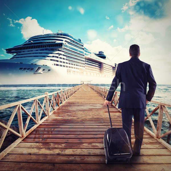 Man walks on a pier carrying a suitcase Stock photo © alphaspirit