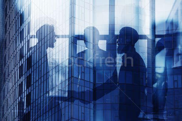 Empresários trabalhar juntos escritório trabalho em equipe Foto stock © alphaspirit