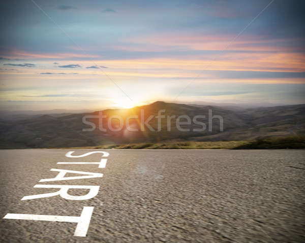 Start written to the ground on a road at sunset. Concept of new beginning and starting new opportuni Stock photo © alphaspirit