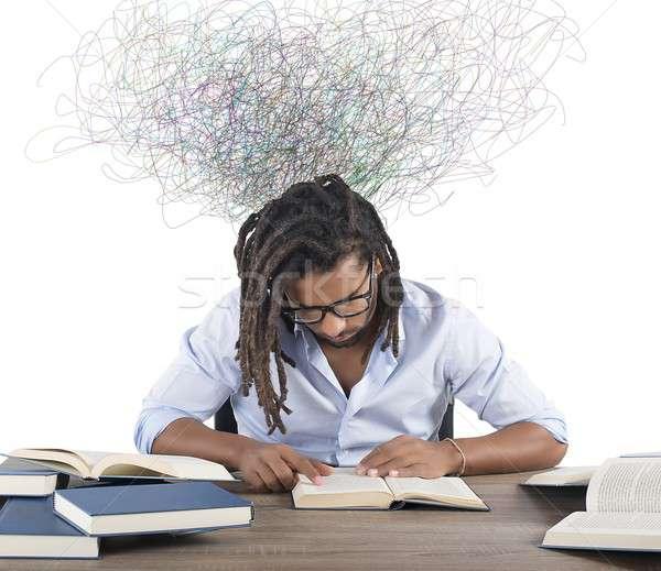 Inspiração livro concentrado homem leitura papel Foto stock © alphaspirit