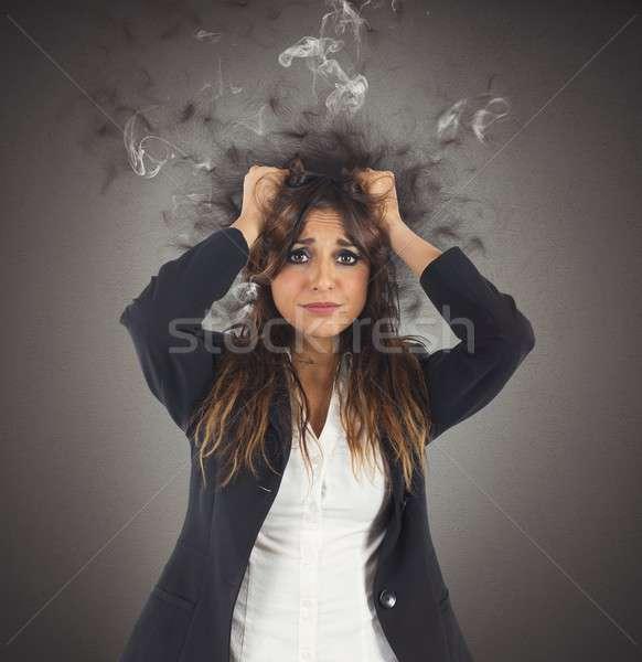 Stressed and desperate businesswoman Stock photo © alphaspirit