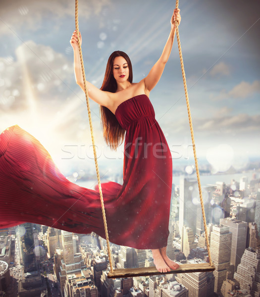 Swing above the city Stock photo © alphaspirit
