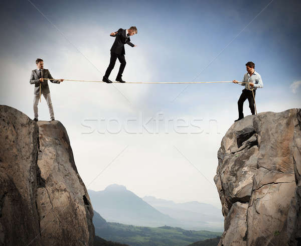 Work together to help a team member Stock photo © alphaspirit