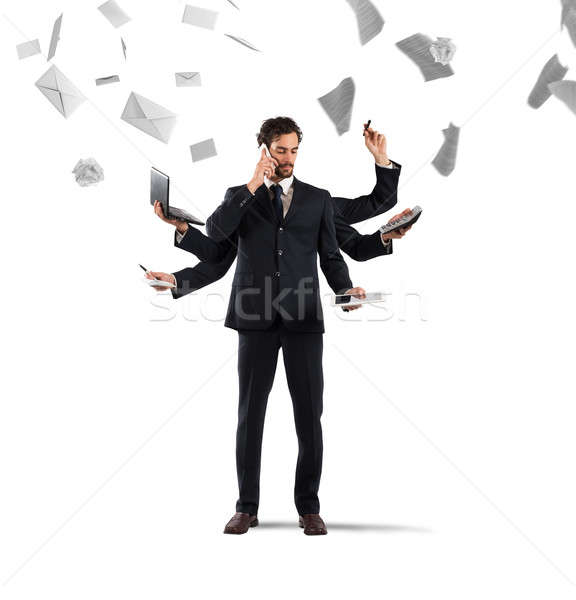 Multitasking businessman Stock photo © alphaspirit