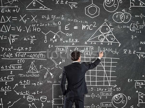 Businessman solve problems with Math calculations Stock photo © alphaspirit