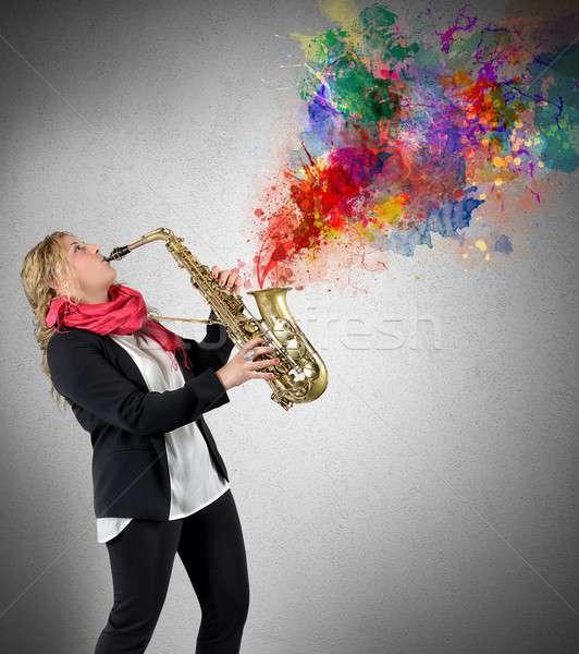 Women saxophonist Stock photo © alphaspirit