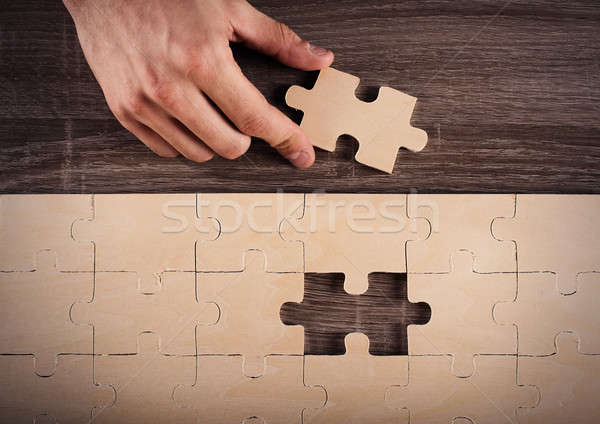 Complete a puzzle Stock photo © alphaspirit