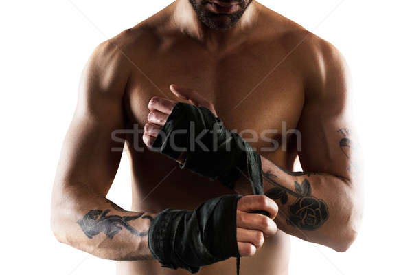 Boxer puts the tapes to his hands Stock photo © alphaspirit
