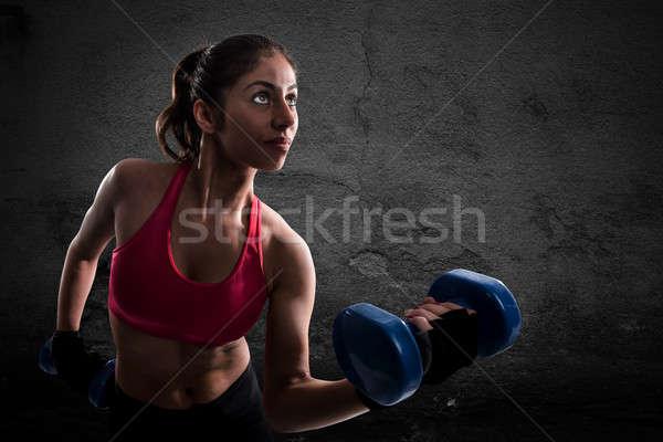 Athletic muscular woman Stock photo © alphaspirit