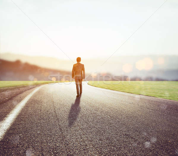 Man walks on an unknown road for a new adventure Stock photo © alphaspirit