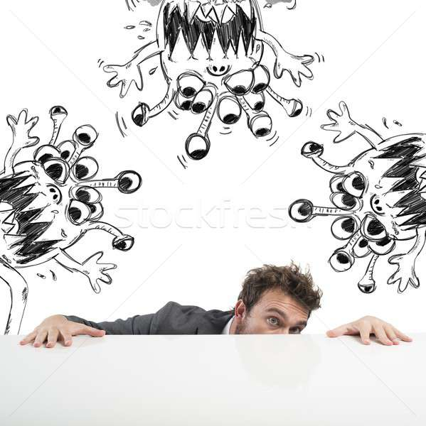 Man hides fearful of the flu virus Stock photo © alphaspirit