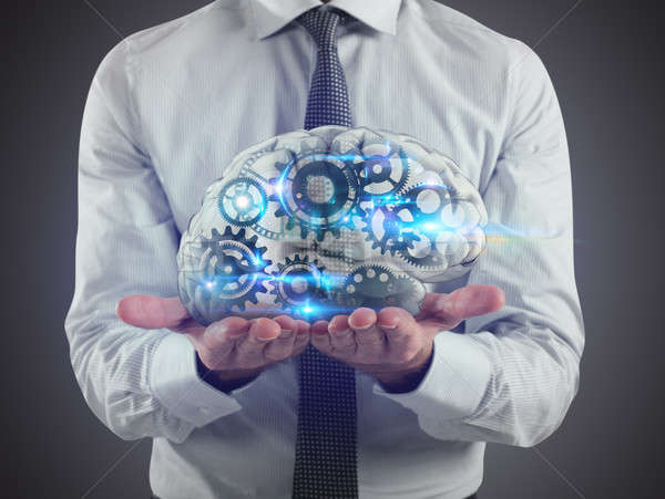 Man holds a brain with gears inside on his hands. 3D Rendering Stock photo © alphaspirit