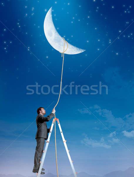 Businessman wants the moon Stock photo © alphaspirit
