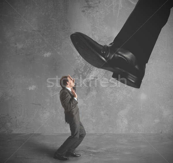 Businessman burdened by taxes Stock photo © alphaspirit