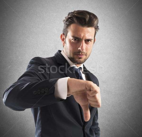 Negative Stimmung Geschäftsmann Daumen nach unten Gesicht Stock foto © alphaspirit