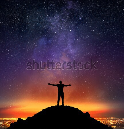 Businessman indicate a falling star Stock photo © alphaspirit