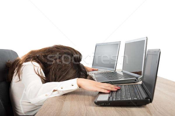 Stressed businesswoman due to overwork Stock photo © alphaspirit