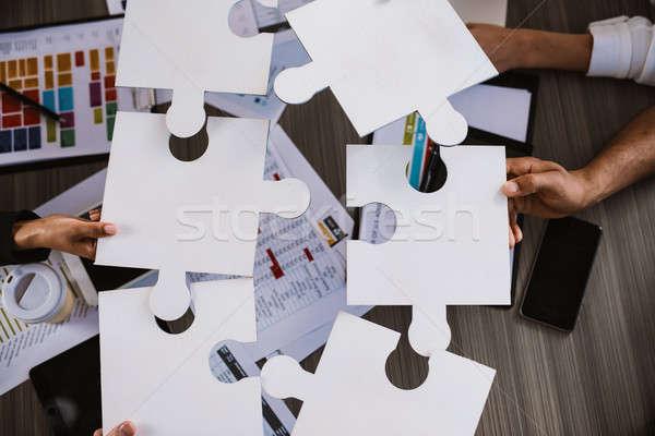 Trabajo en equipo socios integración inicio piezas del rompecabezas empresarios Foto stock © alphaspirit