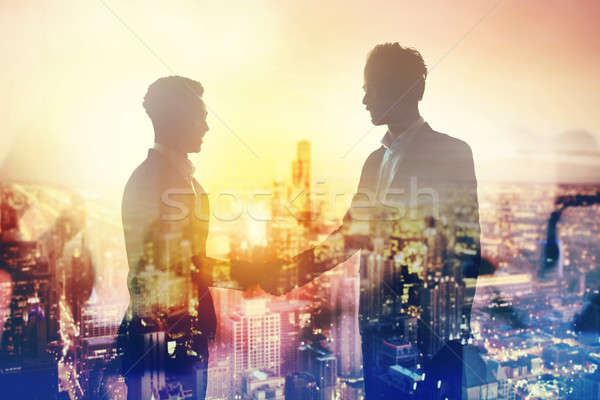 Handshake of two businessperson in office concept of partnership and teamwork Stock photo © alphaspirit