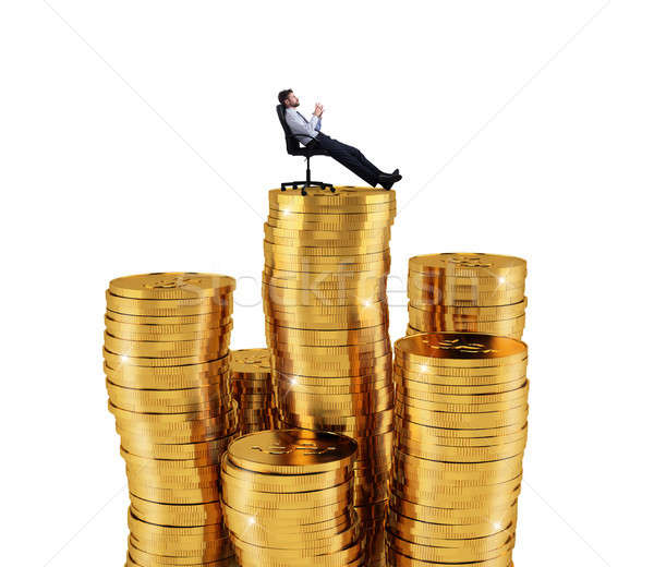 Successful businessman relaxing over piles of money. Concept of success and company growth Stock photo © alphaspirit