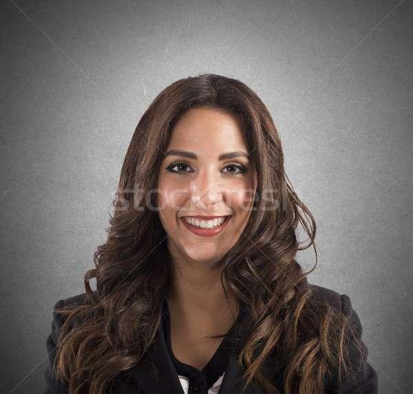 Businesswoman smiling Stock photo © alphaspirit