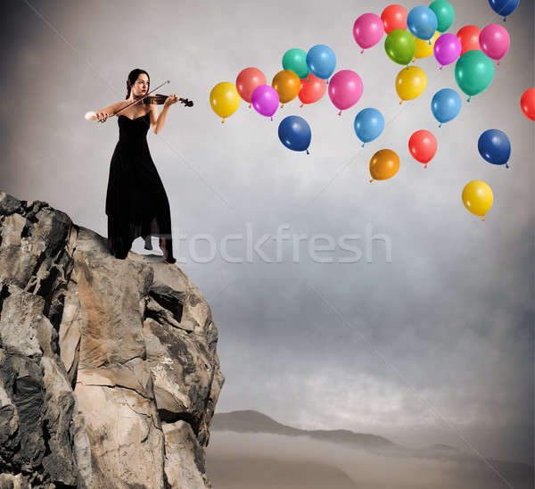 Solo violinist with balloon Stock photo © alphaspirit