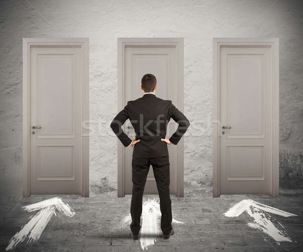 Businessman choosing the right door Stock photo © alphaspirit