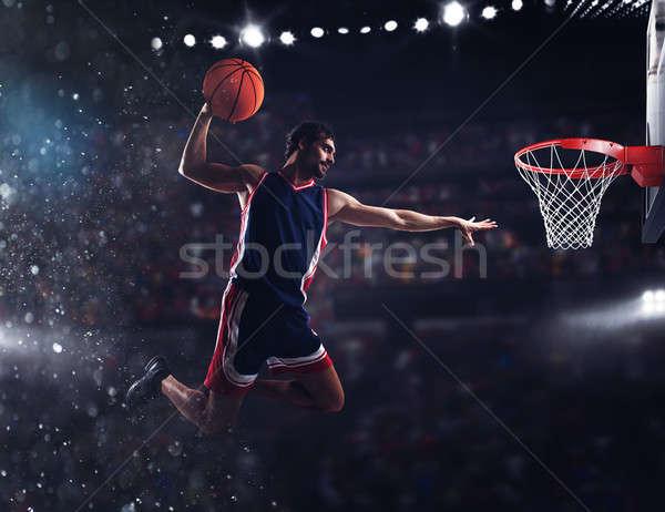 Basket player throws the ball at the stadium Stock photo © alphaspirit