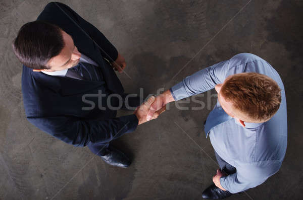 Handshaking business person in office. concept of teamwork and partnership Stock photo © alphaspirit
